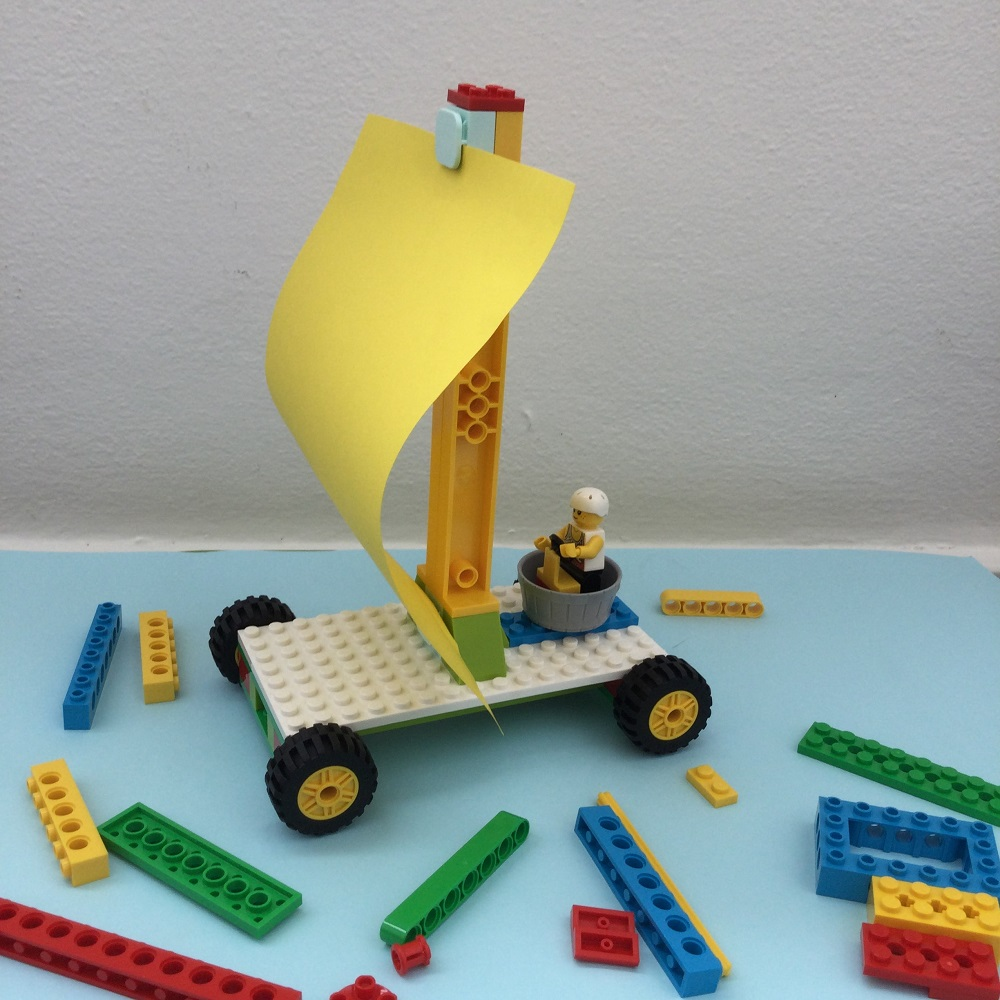 LEGO BricQ Sailing Car Model on table