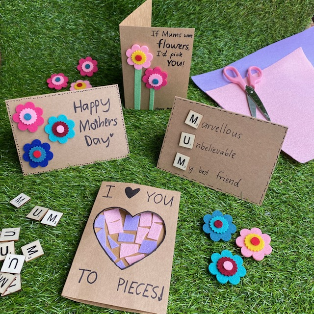 Handmade cards craft activity on grass background