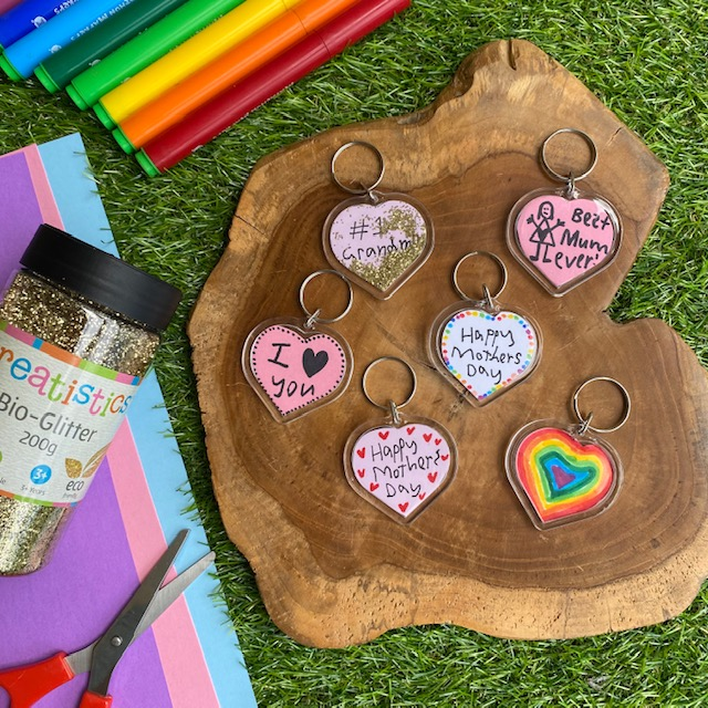 Heart Shaped Keyrings craft activity on grass background