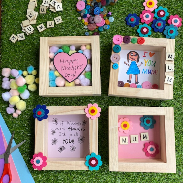 Wooden Box Display Frames craft activity on grass background