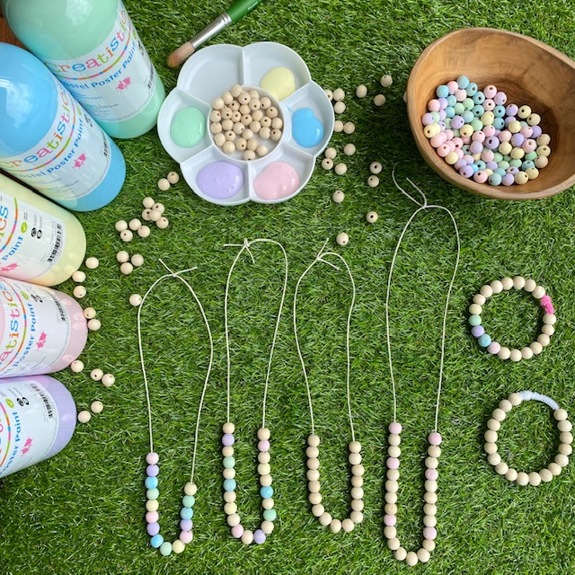 Wooden bead Necklaces craft activity on grass background