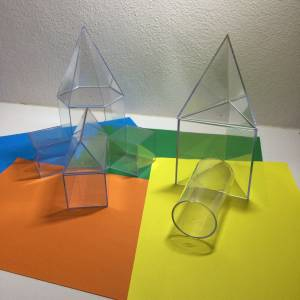 3D clear shapes on coloured card