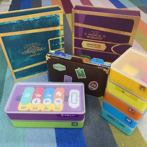 Osmo games and storage containers on floor
