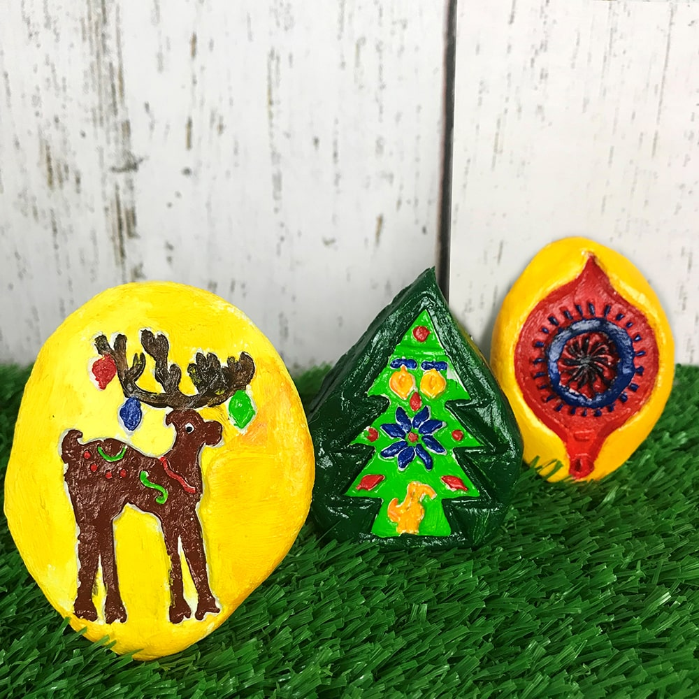 Christmas craft brooches on grass background