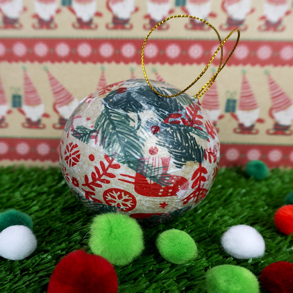 Tissue paper Christmas bauble with festive background